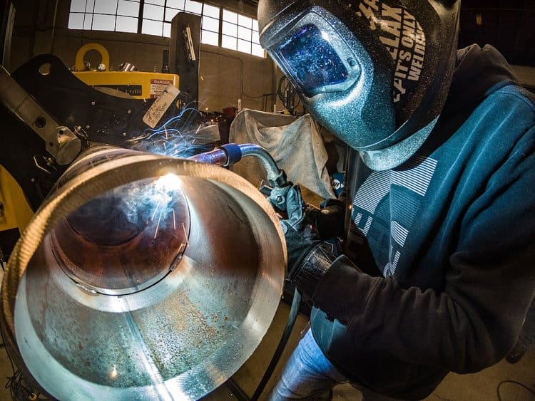 7 reasons why welding is a good career: mig welding a pipe