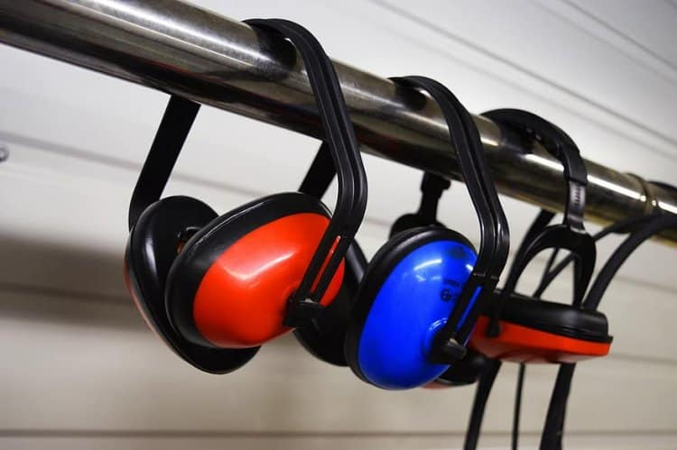 preventing hearing loss with noise reducing headphones can work, but are hard to fit under your helmet